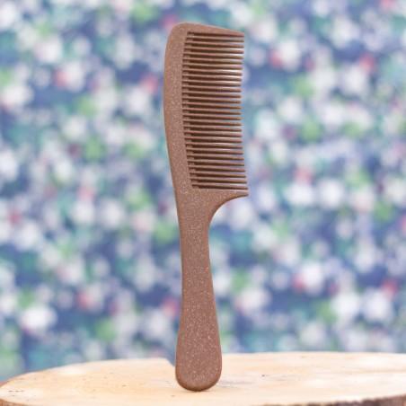 peigne avec manche en bois liquide